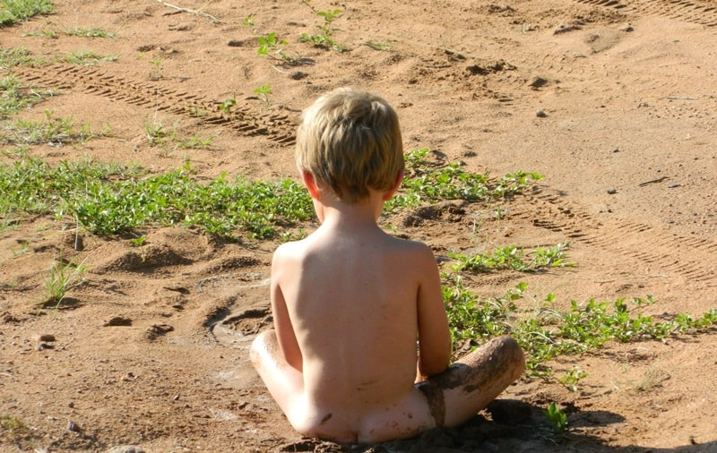 Child sitting in the sand