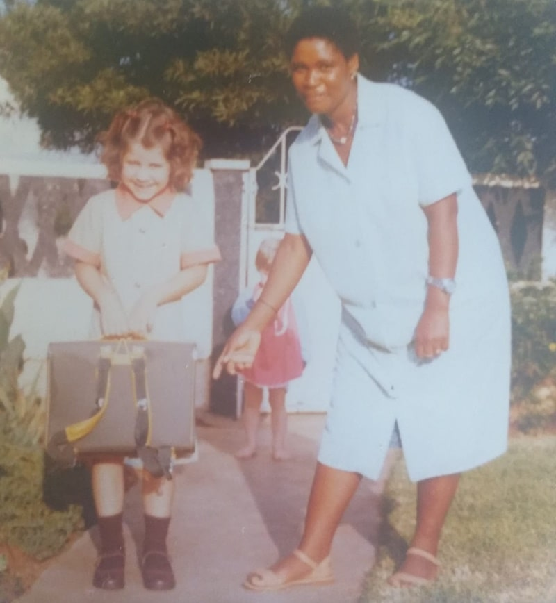 A little girl with her South African maid